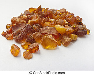 handful of amber on white background