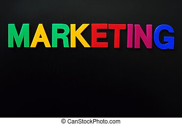Marketing concept of colorful letters on a blackboard