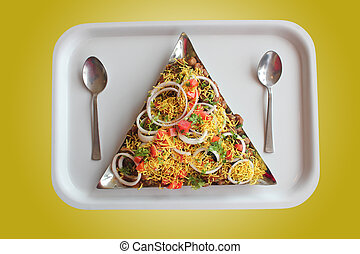 Masala or sev puri - indian chaat snack made with tangy...