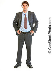 Full length portrait of modern young businessman with hands...