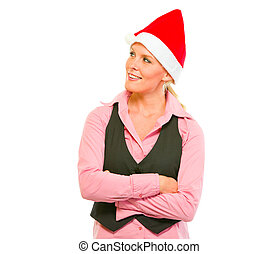 Portrait of smiling modern business woman in Santa Hat looking in corner isolated on white
