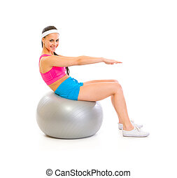 Happy fit female doing abdominal crunch on fitness ball