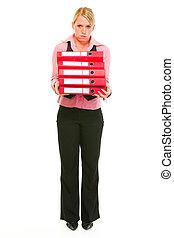 Tired female business secretary holding folders stack