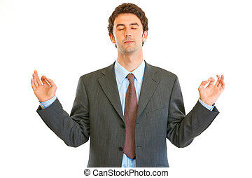 Meditating modern businessman with closed eyes isolated on...