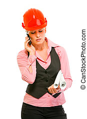 Modern architect woman with flip chart speaking mobile