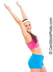 Smiling fit female in sportswear making exercise