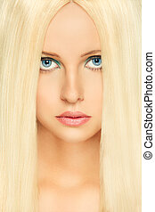 Portrait of blond hair woman with blue eyes. Retouched -...