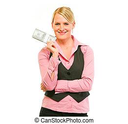 Smiling modern female business secretary holding dollars pack