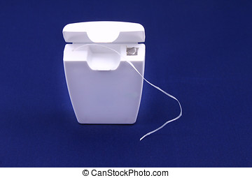 dental floss isolated on blue background