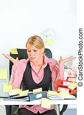 Shocked by set of tasks modern business woman sitting at...
