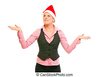 Smiling modern business woman in Santa Hat catching snowflakes