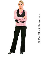 Full length portrait of smiling business woman with crossed...