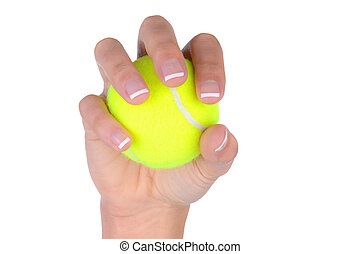 Closeup of woman's hand holding a tennis ball