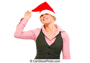 Cheerful office woman with Santa Hat over her eyes isolated...