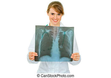 Smiling medical doctor woman holding results of thorax...