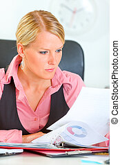 Modern business woman working with documents and checking...