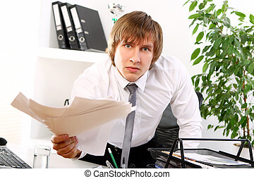 Angry businessman in his office
