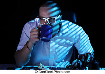 Nerd surfing internet at night time - Funny nerd in glasses...