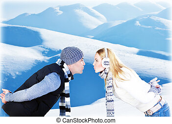 Happy couple playing outdoor at winter mountains - Happy...