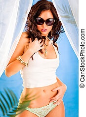 Glamour style photo of beautiful girl in sunglasses posing...