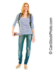 Full length portrait of smiling teengirl with schoolbag holding books in hand isolated on white