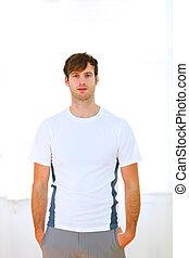Portrait of handsome man in sportswear