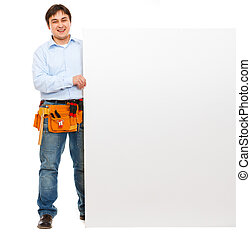 Happy construction worker holding blank billboard