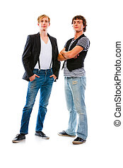 Two modern teenagers posing on white background - Two...