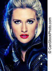 Portrait of beautiful woman in leather jacket. Retouched -...