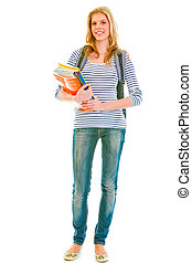 Full length portrait of smiling pretty teen with backpack and schoolbooks isolated on white