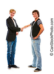 Two modern teenage boys shaking hands. Isolated on white -...