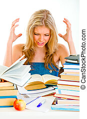Frustrated teengirl with lots of books tired of studying
