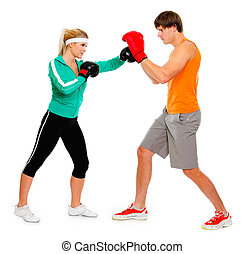 Young woman and man in boxing gloves practicing isolated on...