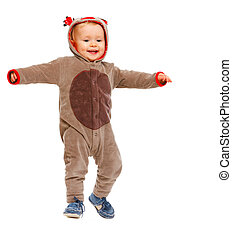 Adorable baby in costume of Santa Clauss reindeer dancing