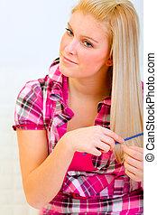 Portrait of pretty woman combing hair