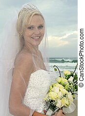 Lovely Bride Under Veil at the Beach - Gorgeous veiled blond...