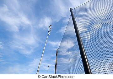 Baseball Net and Stadium Lights Abstract - Wide angle view...