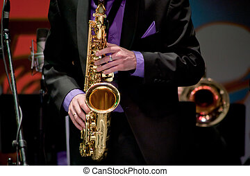 saxophonist plays on saxophone
