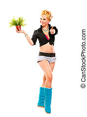 Full length portrait of young girl with flower in pot showing thumbs up gesture isolated on white