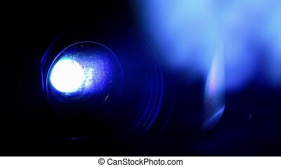 Projector, blue light and smoke Closeup