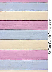 striped colourful painted wood in pink, yellow and blue -...