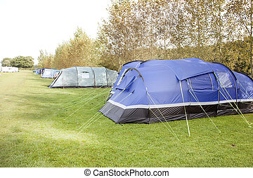 tents in a row on a campsite