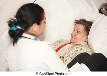 The doctor and old woman - Senior woman is visited by her...