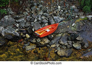 Little boat on the ocean coast during low tide