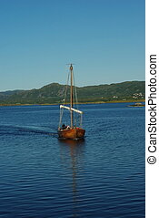 Replica of ancient viking boat on the sea