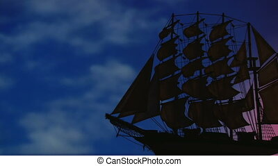 Old sailing ship - Large old sailing ship travels at night...