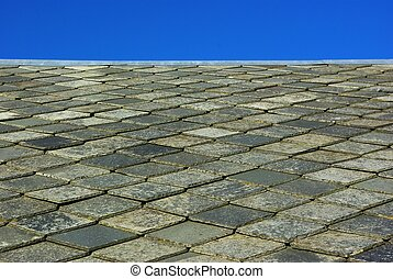 Roof made of slate - Roof made of plates of slate on blue...