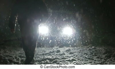 driver and his car in snowstorm - driver in the headlights...