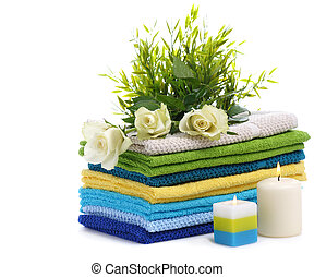 spa towels with white rosesand burn candles isolated on...