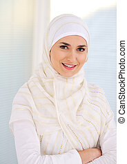 Young beautiful Muslim woman with traditional but...